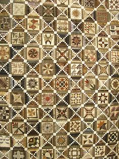 Japanese quilt, alternating sampler blocks and Log Cabin blocks. Also has sashes and setting squares. Interesting combination.