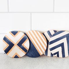Create these simple patterns with copper tape and indigo paint to make a set of stylish coasters