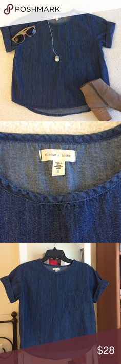 Silence + Noise Denim Cropped Tee Denim cropped shirt from Urban Outfitters. 100% cotton, front pocket, boxy fit. Looks great over shorts, leggings and faded jeans as shown in the photo. Very versatile! Worn a few times but no significant signs of wear. Back is longer than front - length of back from center of collar is about 21.5in. (Last photo from urbanoutfitters.com) Urban Outfitters Tops Crop Tops