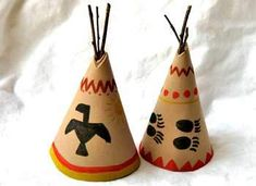 """{Teepee Centerpieces}  Roll a piece of craft foam into the shape of a cone. Use hot glue gun to tack in place.  Trim the top of the teepee on a slant.  Break or cut twigs into 3"""" long pieces. Insert three twig pieces into the top of the teepee, glue in place.  Decorate the outside of your teepees with fun Native American-inspired designs such as bear claws, eagles, stripes and geometric shapes."""