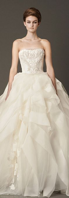 Vera Wang Bridal...Great details. Cheaper to have custom-made than purchasing from salon. Pick 1-3 details to recreate.