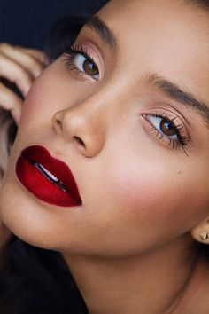 warm and dark bloodlike hue on lips, softened with gentle, antique pink on cheekbones and eyelids, minimal everything else.