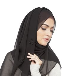 A hijab is a head covering only. It can be worn many different ways including as a simple wrap around, shown here, or Al Amirah style. Regular clothes that cover the arms, shoulders and legs may be worn with the hijab. Women who wear the hijab are Muhajaba, which means they are wearing it for religious purposes.