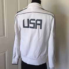 Nike USA jacket Women's USA jacket. Used only a couple times. Small stain in picture. Soccer. Rest assured that your purchased items come from a clean and pet free home. Check out my love notes in my profile!  offers welcome Nike Jackets & Coats