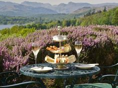 Afternoon wine takes the place of afternoon tea in the spectacular gardens of Holbeck Ghyll Country House Hotel, off Lake Windermere. A splendid way to relax.