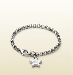silver bracelet with gucci trademark star charm