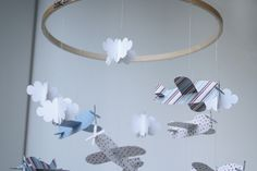 DIY how to on how to make a paper plane mobile.