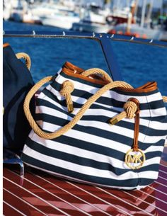 Small beach bag. My towel definitely won't fit in that, and also.. Would I reaaallyyy want to get sand and sea blast on my Michael Kors bag?? No noo