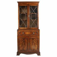 """Display your favorite curios while stowing extra linens in this vintage English bookcase bureau, featuring a glass-door bookshelf on top and bottom cabinet. All locks work and come with 3 keys.  Product: BookcaseConstruction Material: MahoganyColor: BrownDimensions: 71.75"""" H x 29.75"""" W x 14"""" DNote: Due to the vintage nature of this product, some wear and tear is to be expected. Products may show signs of brand marks, scrapes or other blemishes.Cleaning and Care: Wipe with damp cloth"""