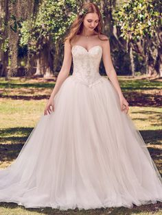 Maggie Sottero - BENTON, Lace motifs dance over a Keela Mikado bodice in this princess wedding dress, featuring sweetheart neckline, basque waist, and tulle ballgown skirt. Lined with shapewear for a figure-flattering fit. Finished with crystal buttons over zipper closure.