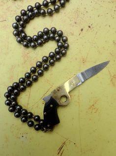 Vintage Gun souvenir lock Knife brass chain Unisex found object Necklace Unisex gift Lux Revival collage Dude. $52.00, via Etsy.