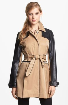 tan and black faux leather trench