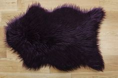 To enjoy safe winter, order for this Soft Contemporary Faux Fur Aubergine Sheepskin Style Rugs in 60 x 90cm size.