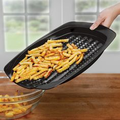 """Pinner: """"This amazing pan creates perfectly crispy baked fries, chicken nuggets and more with no oil required!"""""""