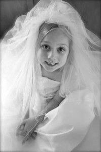 Little girl in mom's wedding dress - to display at her wedding