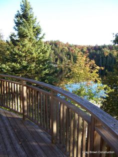 Curved Cedar railing over looking lake in Haliburton, Ontario.