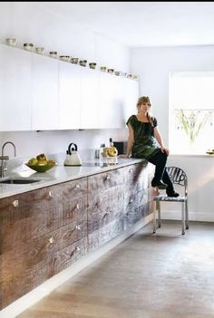 concrete floor, wood unders, white counter, white uppers.