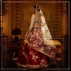 A red velvet lehenga paired with a veil in soft tulle. #TarunTahiliani #ReadytoWear #IndianWear #BridalWear #Classic #Floral
