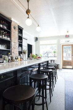 Choose white quartz surface for a bar top design for your stylish restaurant remodel and decoration