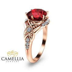 Stunning feminine and breathtaking! This Cushion cut engagement ring is crafted in solid 14k Rose gold with a 2.20carat Cushion shaped Lab Created Ruby into a gorgeous vintage basket setting on top of a diamond halo. The timeless and classic design of this floral ring will make your engagement unforgettable.  SETTING #SKU: ANcu-0008C Metal: 14K Rose Gold (Available Also in 14K Yellow Gold or 14K White gold - No Extra Charge) Certificate: CJC (Camellia Jewelry Certificate) Ring Size: 6.5…