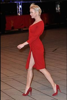 Renee Zellweger appearing at the 59th Berlin Film festival wearing a red dress with a daring slit to reveal her sexy legs in high heels.