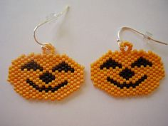 Cutest Halloween pumpkins on a friendly, smiling Jack 'o Lantern hand stitched seed bead pierced earrings just in time for Halloween. The earrings are mounted onto silver-filled French hook ear wires Halloween Beads, Halloween Earrings, Halloween Jewelry, Holiday Jewelry, Halloween Pumpkins, Gold Bar Earrings, Seed Bead Earrings, Pierced Earrings, Beaded Earrings