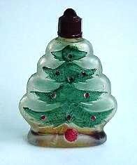 Vintage Christmas Tree Perfume, Made in Roumania… frosted glass, green painted branches, with red bulbs, impressions of toys lying at base of  tree; a red hard plastic screw cap designed so it could be used as tree ornament