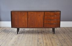 Beautiful, Danish sideboard in rosewood. With four drawers on the right hand side and a lockable cupboard on the left hand side.