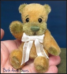 Trenton by **Beth Franco Bears** . 2 3/4 inches sitting and 3 1/4 inches tall.