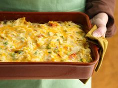 Rotel Chicken Mexican Casserole  3 split fryer breasts cooked and cubed 1 bag of tortilla chips crushed 1 can of Rotel 1 can Cream of Chicken soup 1 small can of chopped green chiles 1 lb of Velvetta or American Cheese (see comments)
