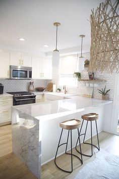 this kitchen with the subway tile and wood accents #kitchen #subwaytile