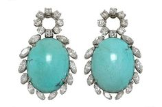 With a captivating, refreshing robin's egg blue, these Persian turquoise cocktail earrings command attention. Of significant size, surrounded with a halo of 20 dazzling marquise and round diamonds totaling 2.16 Ct. 1970s Vintage, they dangle from a central diamond circle and provide excitement with color and motion. #turquoise #diamond #earrings #estatejewelry #earrings #persianturquoise #robinsegg  #turquoiseearrings #cocktailjewelry #statementjewelry #earring #blue #diamonds…