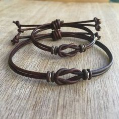 Dark Brown Leather Matching Bracelets These lovely bracelets are made with genuine leather cord, brown rubber spacers, and sterling silver links. Designed for couples Both bracelets are adjustable Includes: Gift Box + 2 Bracelets In black color Bracelet Couple, Bracelet Love, Couple Jewelry, Bracelet Cuir, Cord Bracelets, Bracelets For Men, His And Hers Jewelry, Matching Couple Bracelets, Pearl Necklaces