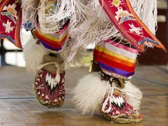 Alex Pelkey, 17, Lawrence, steps in time to the beat of a drum while performing a Native American grass dance at the annual Festival of Cultures on Sunday, Sept. 25, 2011 at South Park in downtown Lawrence.