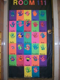 Classroom door with decorated hand cut-outs.
