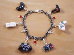 Video Game Controllers Charm Bracelet - Polymer Clay - XBox, Wii, NES, Atari, Playstation, Sega -Made To Order. $35.00, via Etsy.