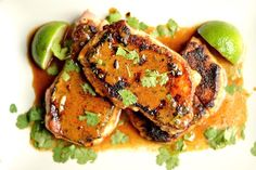 Creamy & Smoky Chipotle Pork Chops (Paleo, Whole 30)4-5 Boneless Center Cut Pork Chops (about ¾ - 1 inch thick) 2 tbsp olive oil For the rub: 1 tbsp chili powder 1 tsp paprika ½ tsp cumin ½ tsp chipotle chili pepper spice ½ tsp coarse sea salt 1 cloves garlic, minced For the sauce: 1 cup canned coconut milk ½ tsp chipotle chili pepper spice 1 tsp liquid smoke ¼ cup chopped fresh cilantro For garnish: Juice of 1 lime Chopped fresh cilantro