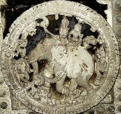 According to Vastu - India being the guardian deity of the north - this image is carved in the ceiling of the northern portion of the central hall common to the three shrines. Indra is portrayed as riding his vehicle, the four tusked white elephant called Airavat. Also seen on the elephant is Indra's consort Indrani.