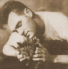 Morrissey is ALWAYS hanging out with cats.
