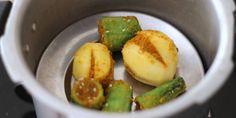 Bharwa Karela with Besan stuffed karela potato sabji recipe - authentic bharwa karela sabji prepared in onion tomato punjabi gravy. step by step recipe. Veg Recipes, Curry Recipes, Indian Food Recipes, Vegetarian Recipes, Cooking Recipes, Potato Sabji, Using A Pressure Cooker, Veg Dishes, Gujarati Recipes