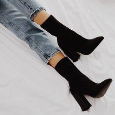 Black mid-calf boots.