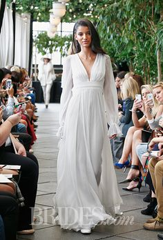 Long sleeves with a flowy silhouette by @delphinemanivet   Brides.com