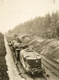 A Russian armoured train, Partizan, is pictured motionless on its tracks. The train is shown to have three cars and a weapon at its front, hidden beneath armour plating. The train assisted the Red war effort in the Vyborg area. Finnish Civil War, Afghanistan War, Military Photos, Fighter Pilot, United States Army, Korean War, Military Equipment, Panzer, Armored Vehicles