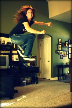 Wow...jump so high!  Her hair, hands, face and feet are all bluried.