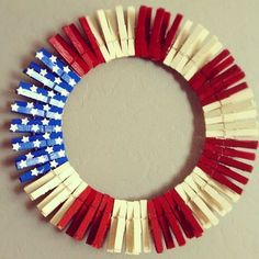 Here a way to upcycle clothespins. Make this pretty patriotic wreath! See the tutorial at Cat's Craft Room