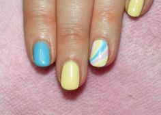 """Shellac in """"Sun Bleached"""" and """"Azure Wish"""" with pastel rainbows on her feature nails."""