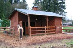 Small Pole-Frame Horse Barn - This pretty little pole barn has two stalls, a tack room and a sheltering roof. It was built from the Prescott Barn plans, available at HomesteadDesign.com