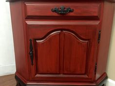 """Farmhouse Corner Hutch China Cabinet Painted in Brick Red, Black Wood Stain and Pitch Black Glaze.  Dimensions H69""""x W35""""x D19""""  By Made New"""