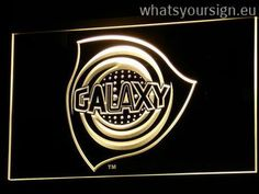 Los Angeles Galaxy - LED neon sign light display made of the premium quality transparent acrylic and briliant colorful lighting. The neon sign looks exactly the same from every angle thanks to the carving with the modern 3D laser engraving process. This LED neon sign is a great gift idea! The neon is provided with a metal chain for displaying. Available in 3 sizes in following colours: Green, Purple, Orange, Red, Yellow, Blue and White!