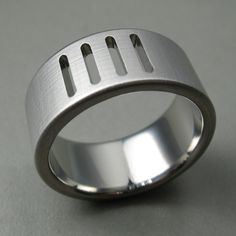 Saw Cut Titanium Wedding Ring. $298.00, via Etsy.